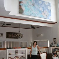 Artist Noe Tanigawa and her painting installed at the residence of U.S. Ambassador to Palau.