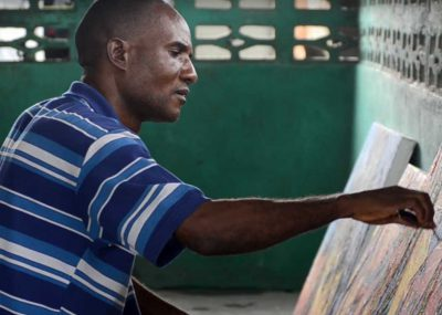 Local artist painting in Monrovia