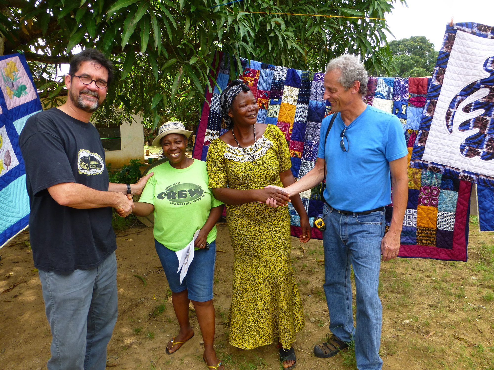 Working Man collective members Tom Ashcraft and Peter Winant with Alice and Maud and their quilts