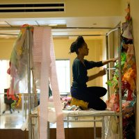 Maya Asante installing her work in the U.S. Embassy Antananarivo