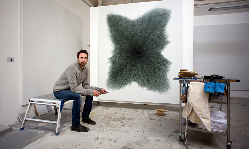 Idris Khan with his commissioned work for the U.S. Embassy Islamabad