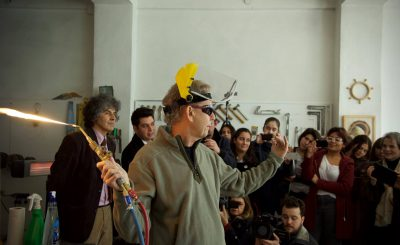 Artist Dennis Lee Mitchell gives a demonstration of his 'smoke drawing' technique to vocational high school students at OSTIM, the Ankara studio of Turkish artist Turhan Çetin.