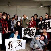 Local high school students and teachers pose with Dennis Lee Mitchell and their own 'smoke drawings' after a workshop at OSTIM in Ankara.
