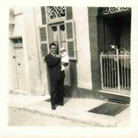 Photographer Unknown, Grandfather Maurice Attard with uncle David Attard in front of their house in Bormla, Overall: 10 x 10in. (25.4 x 25.4cm), Courtesy of Susan Victoria Attard, Malta