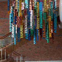 Yael Kanarek, Day & Night, Custom designed metal hanging sculpture composed of 76 individual words painted in an assortment of colors. Overall weight: 793.9 lb. (360.1 kg)