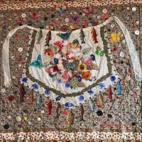 Jane Burch Cochran, Apron Memories, Fabric, painted and stenciled canvas, apron, buttons, beads, gold leaf, trims, ribbon, rickrack, hand embellished, hand appliqu�d using beads, Overall: 44 × 49in. (111.8 × 124.5cm), Courtesy of the artist, Burlington, Kentucky