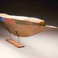 Julie Girardini, Vessel of Knowledge, Metal, books, Overall: 56 × 10 × 6in., 15lb. (142.2 × 25.4 × 15.2cm, 6.8kg), Courtesy of the artist, Sykesville, Maryland