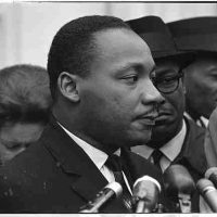 Warren K Leffler, Martin Luther King, Jr. after meeting with President Johnson at the White House to discuss Civil Rights, December 3, 1963, Black and white photographic print, Overall: 13 x 16 x 1 in. (33 x 40.6 x 2.5 cm), Collection of Art in Embassies, Washington, D.C.; Library of Congress Prints and Photographs Division, LC-U9-10978-A-3