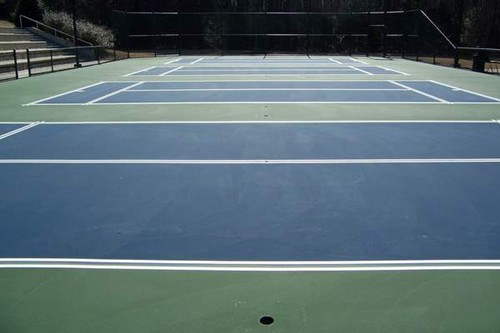 Prior to the application of the court playing lines, painters tape is applied and primed to establis