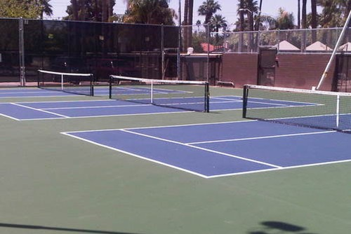 Three stand alone 36' tennis courts for Kids Tennis using the US Open blue/green color scheme!