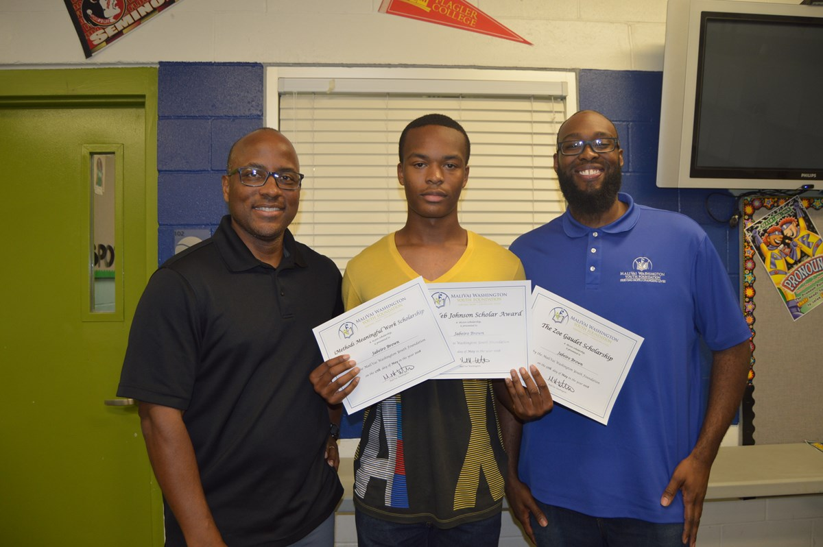 Jabeiro Brown with his scholarship awards. Photo courtesy of the MaliVai Washington Youth Foundation.