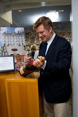 Alec Baldwin signing a bottle of Moet & Chandon