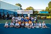 Kyrgios and Sock with kids from the Sportsmen's Tennis & Enrichment Center.