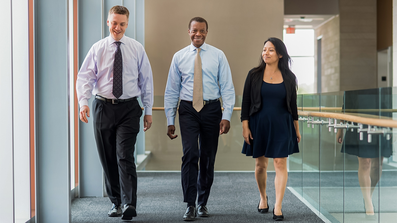 Martin Harris walking alongside two other individuals.