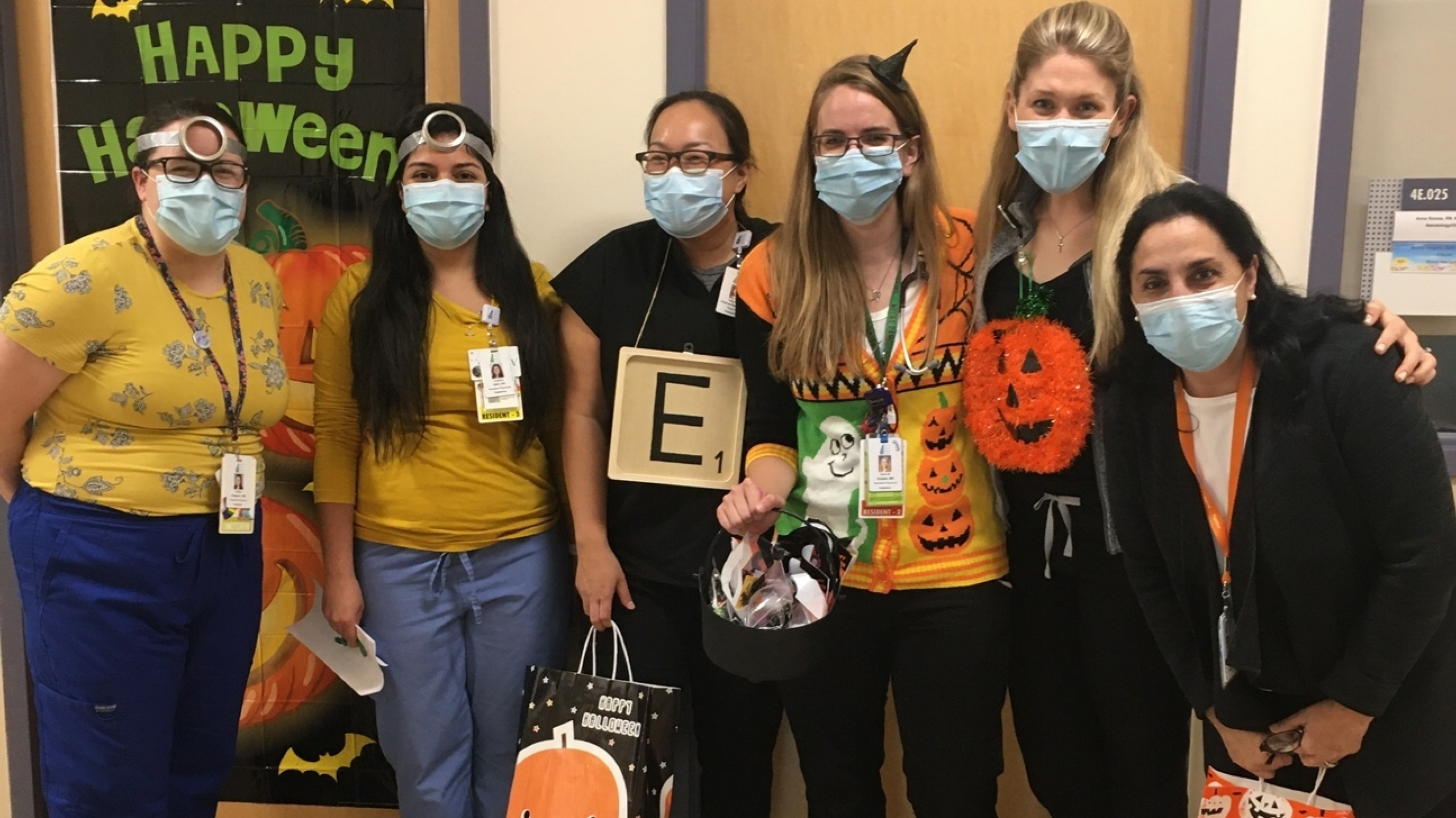 Pediatrics residents and faculty in a group during their reverse trick-or-treat parade.