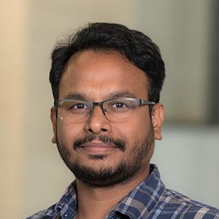 Headshot of Ajay Abraham.