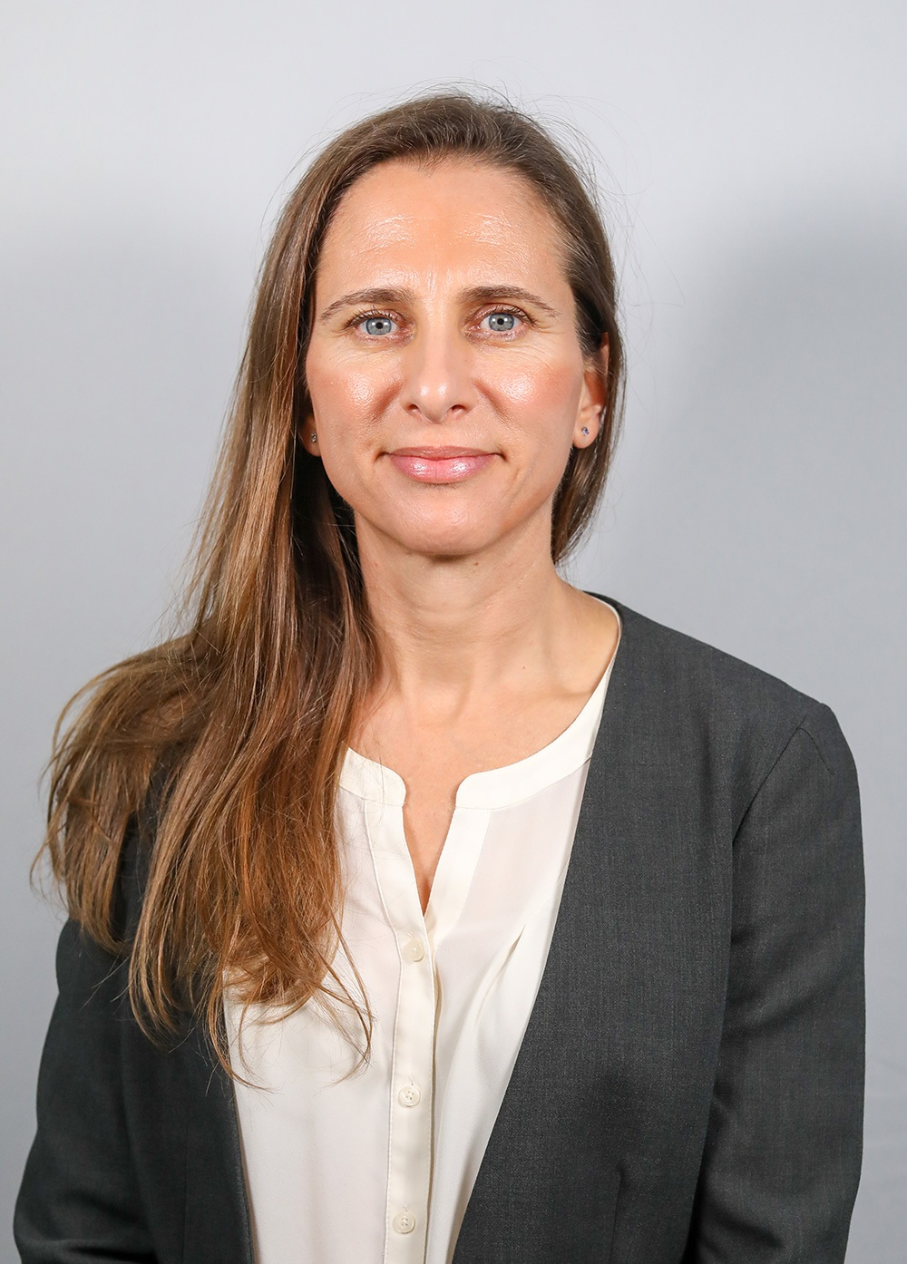 Headshot of Alexandra Lamari Fisher.