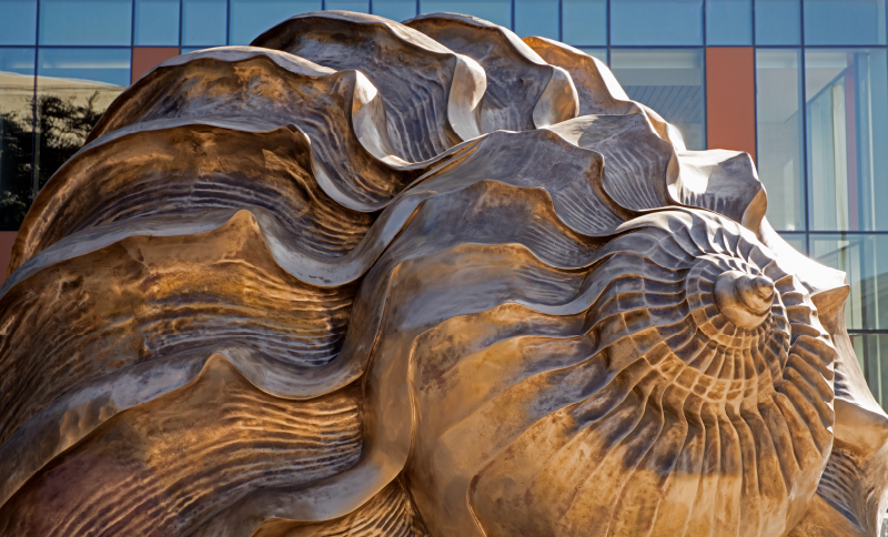 Art structure of a conch in front of the Health Learning Building