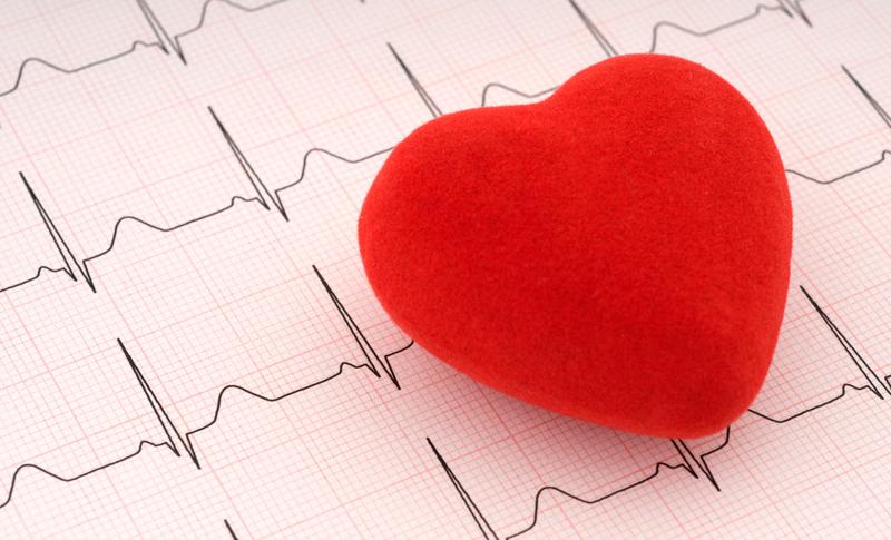 A felt heart on top of an EKG graph.