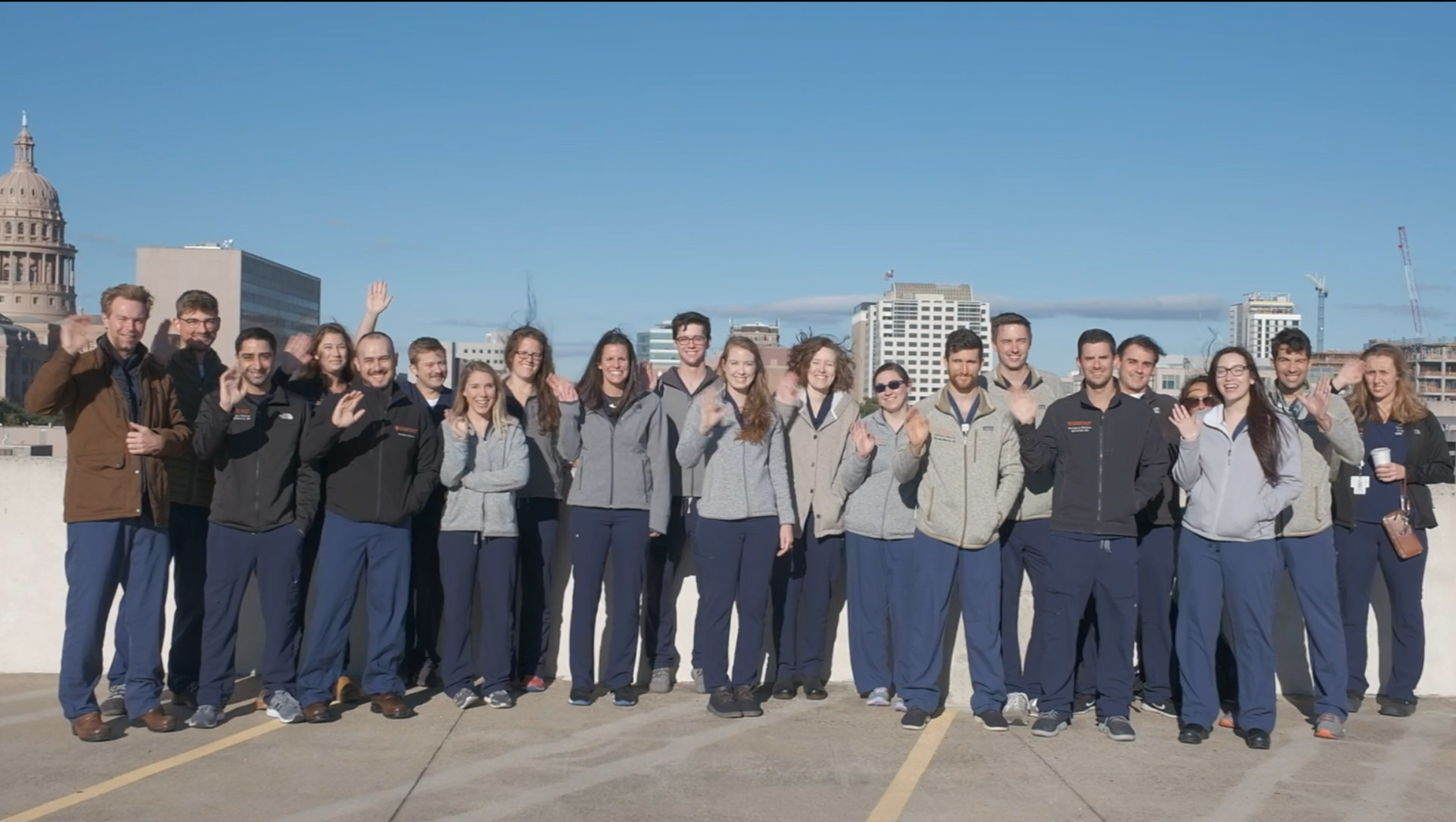 The Emergency Medicine Residency class in a group with the Texas Capitol in the background.
