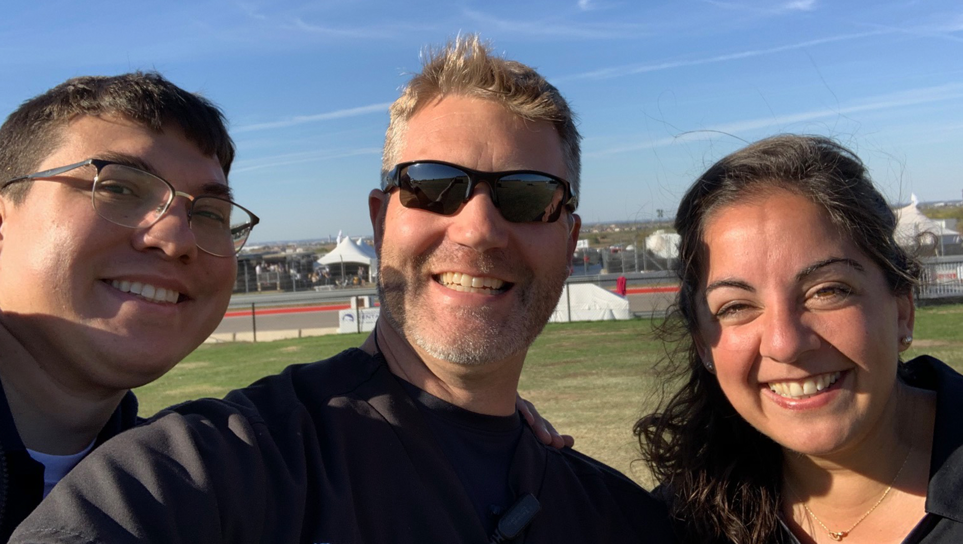 Three EMS physicians smiling.