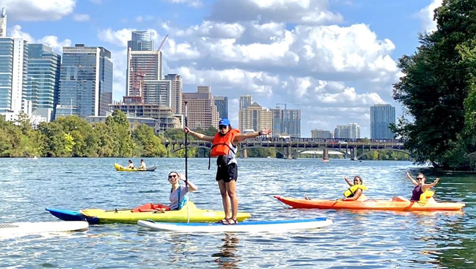 Four Family Medicine residents kayaking at Lady Bird Lake in Austin, Texas.