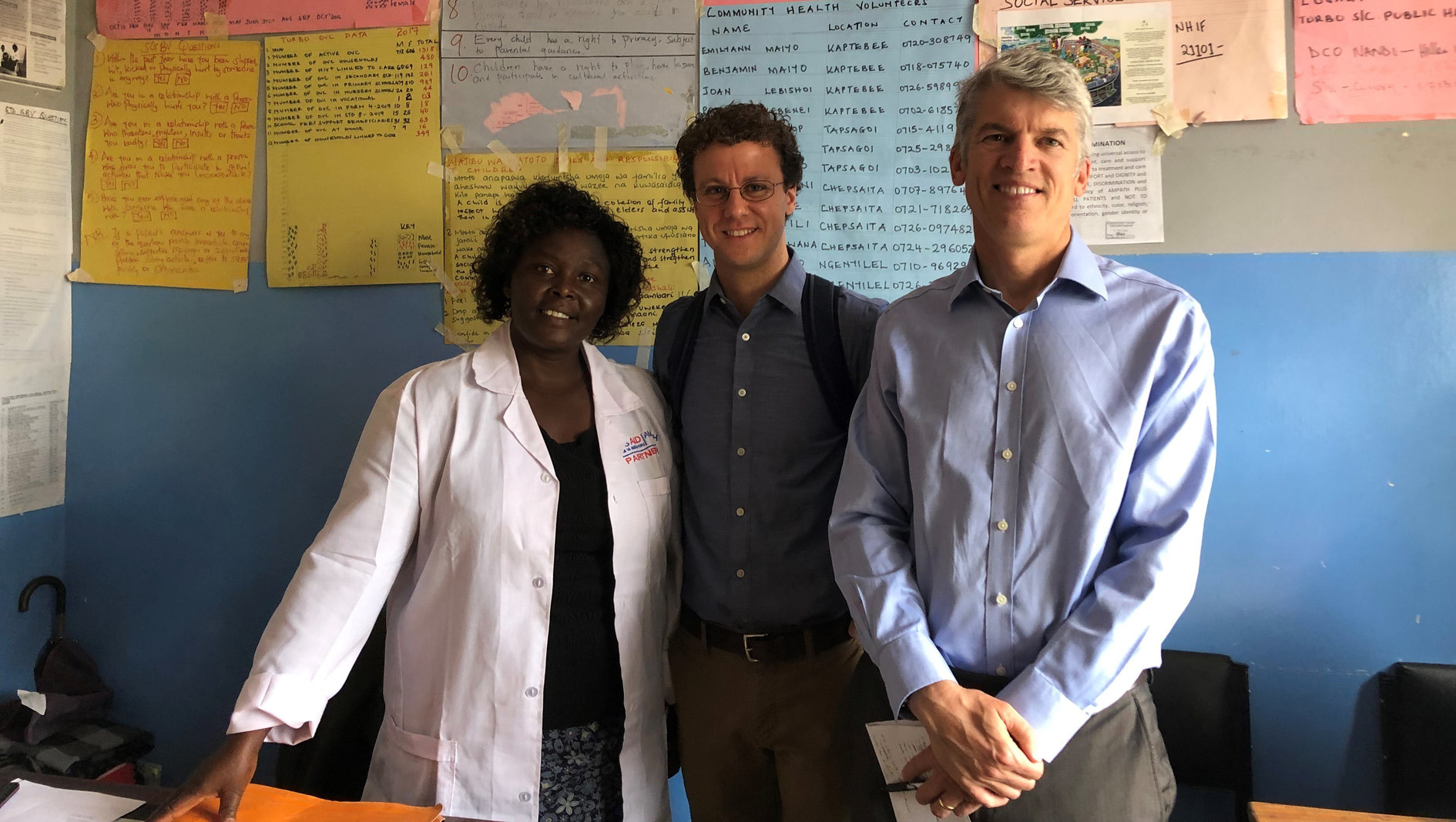 Dell Med Dean Clay Johnston and Division of Global Health Director Tim Mercer with a partner faculty member in Kenya