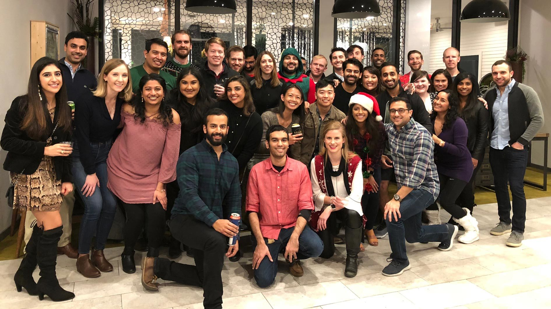 Internal Medicine residents in a group at a holiday party.