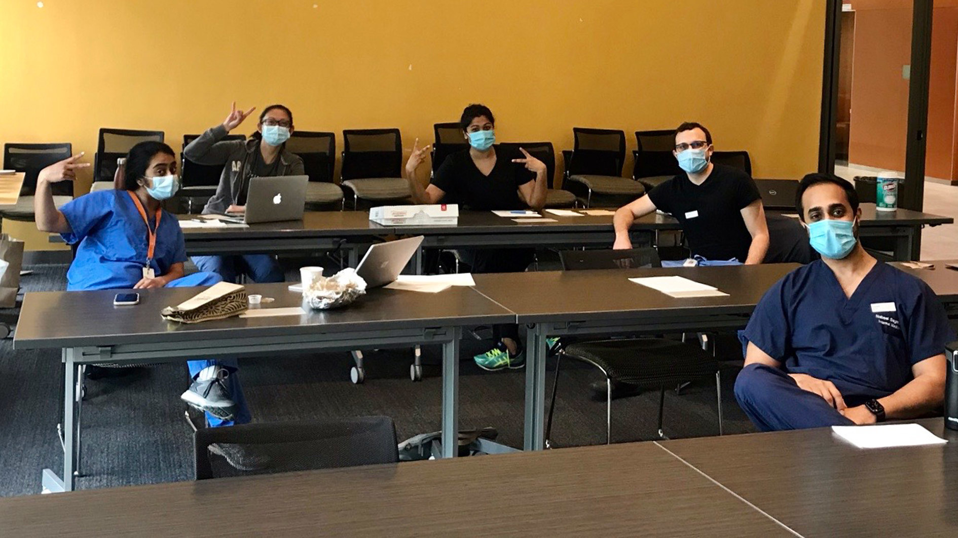 Five Internal Medicine residents spaced out in a classroom studying.