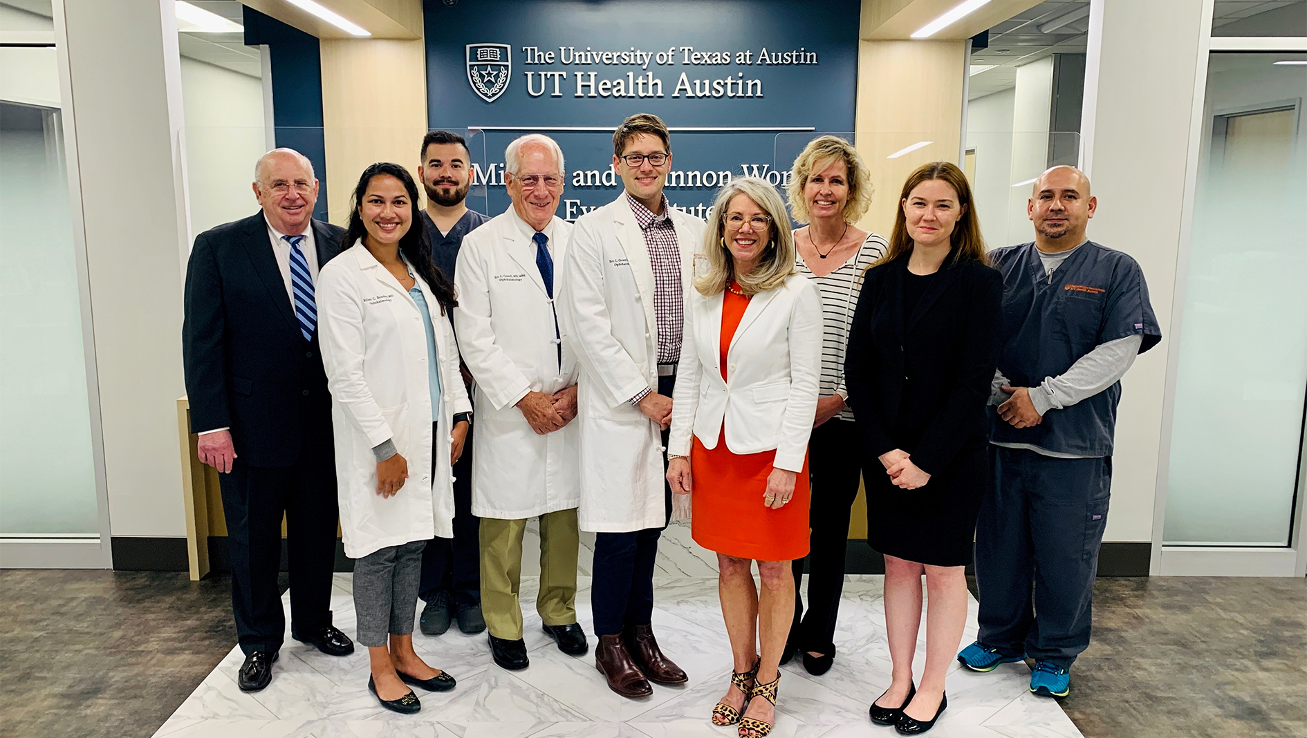 Nine members of the Ophthalmology Residency in a group photo.
