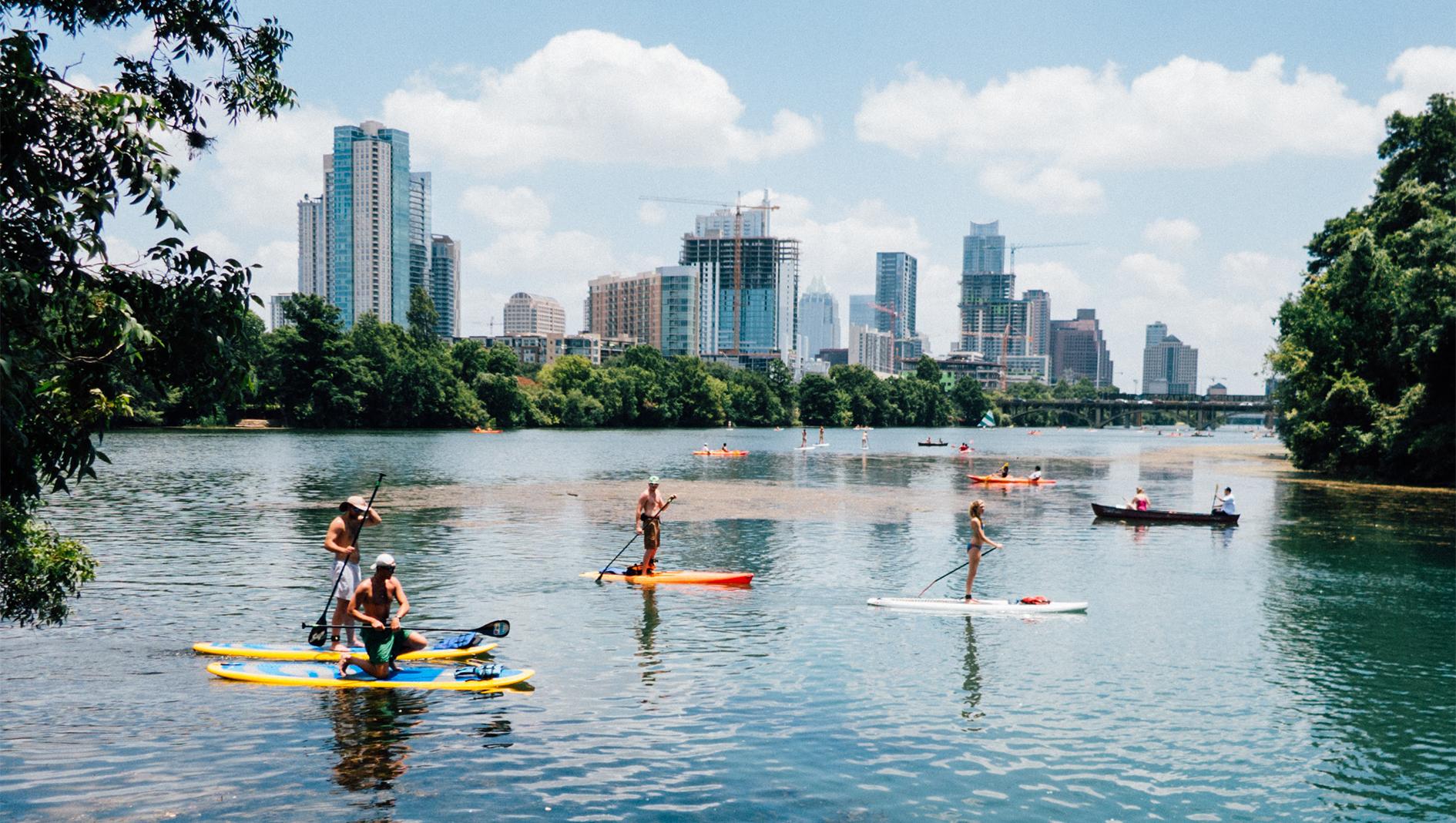 Individual paddle boarding at Lady Bird Lake in Austin, Texas.