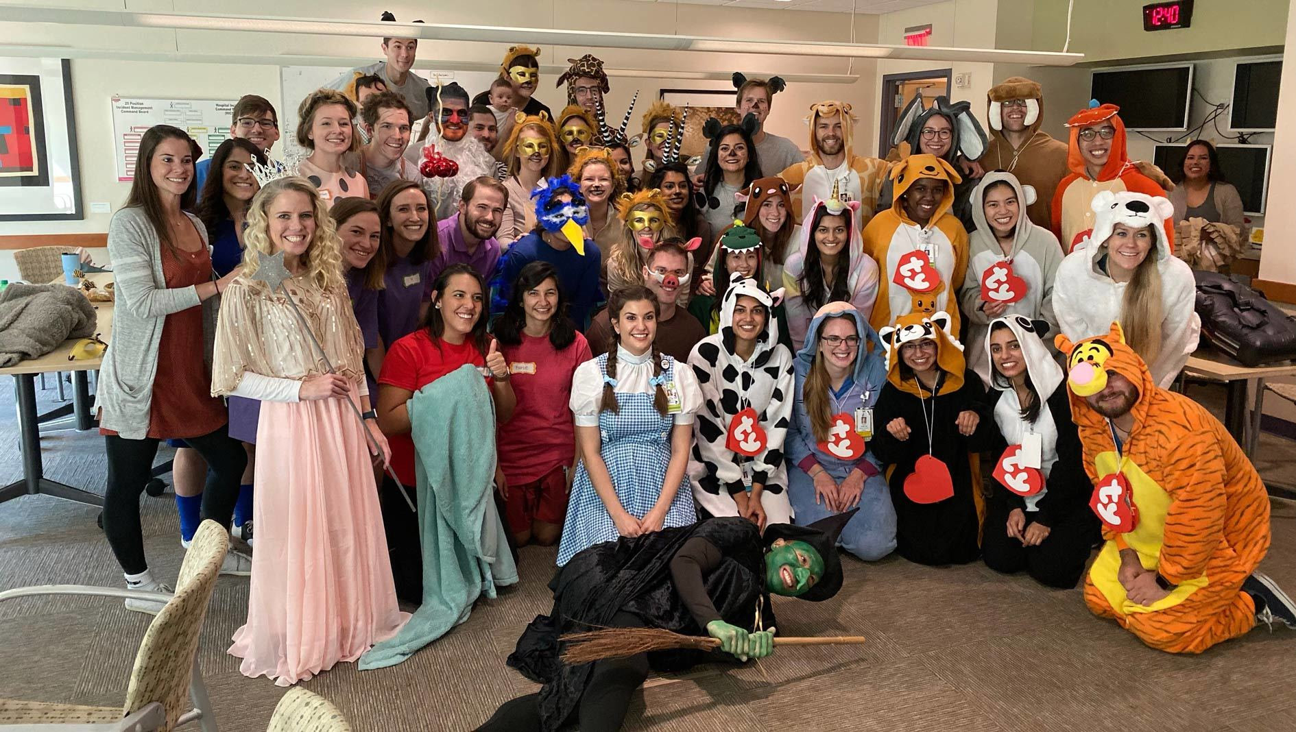 A group of pediatrics residents dressed up in Halloween costumes for the kids.