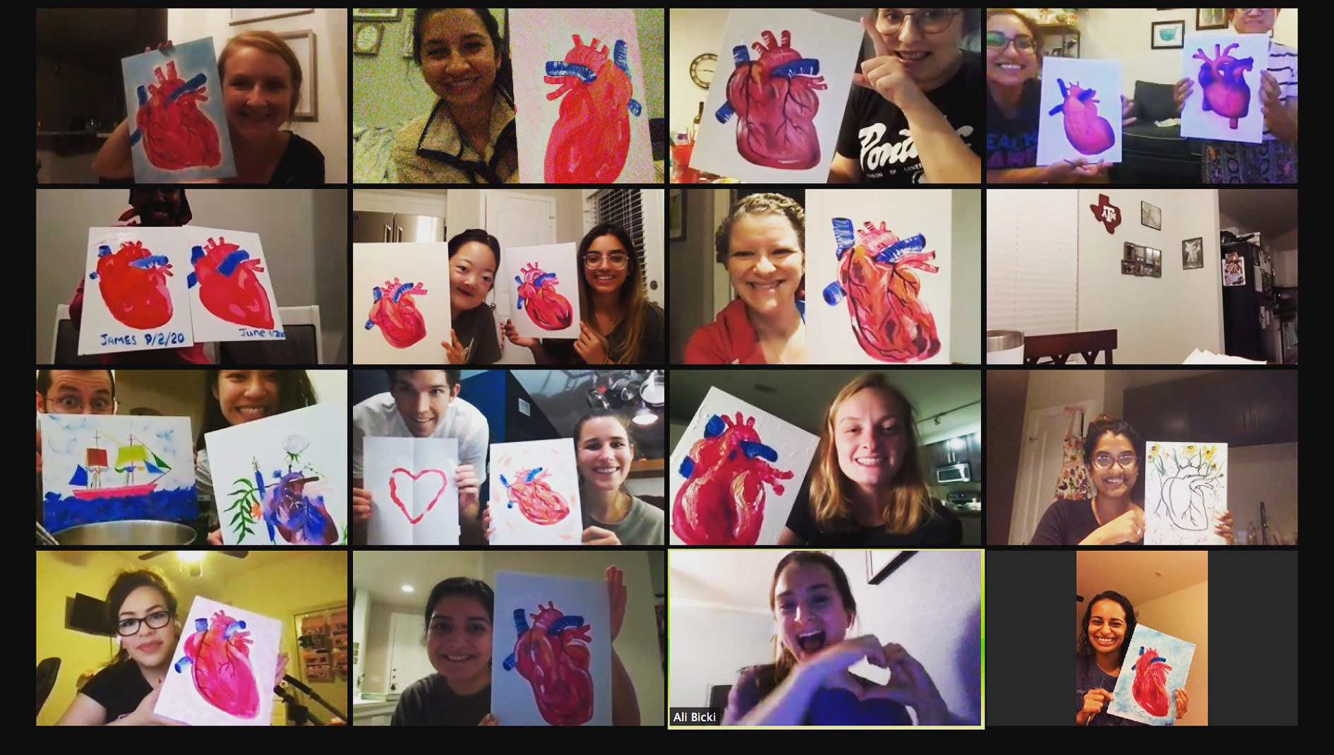 A group of pediatrics residents on a video call holding up paintings of hearts that they created.