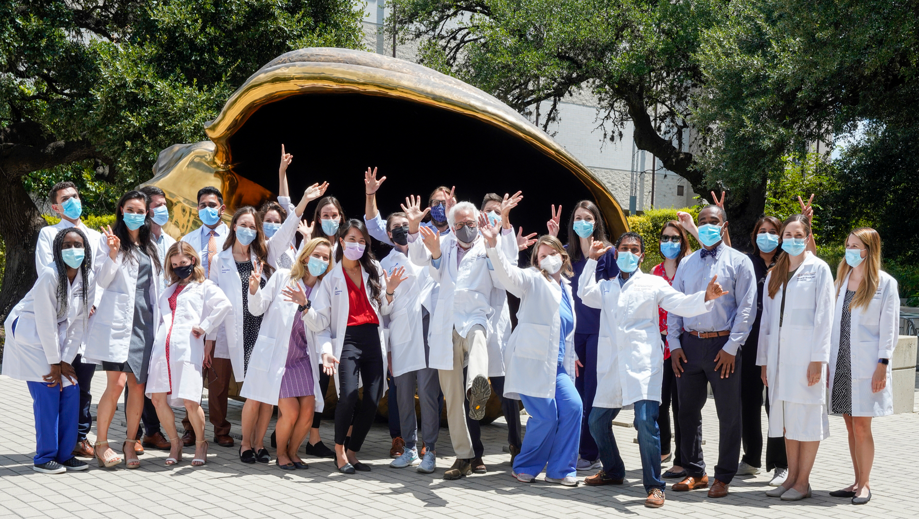 Members of the Dermatology Residency in funny poses.