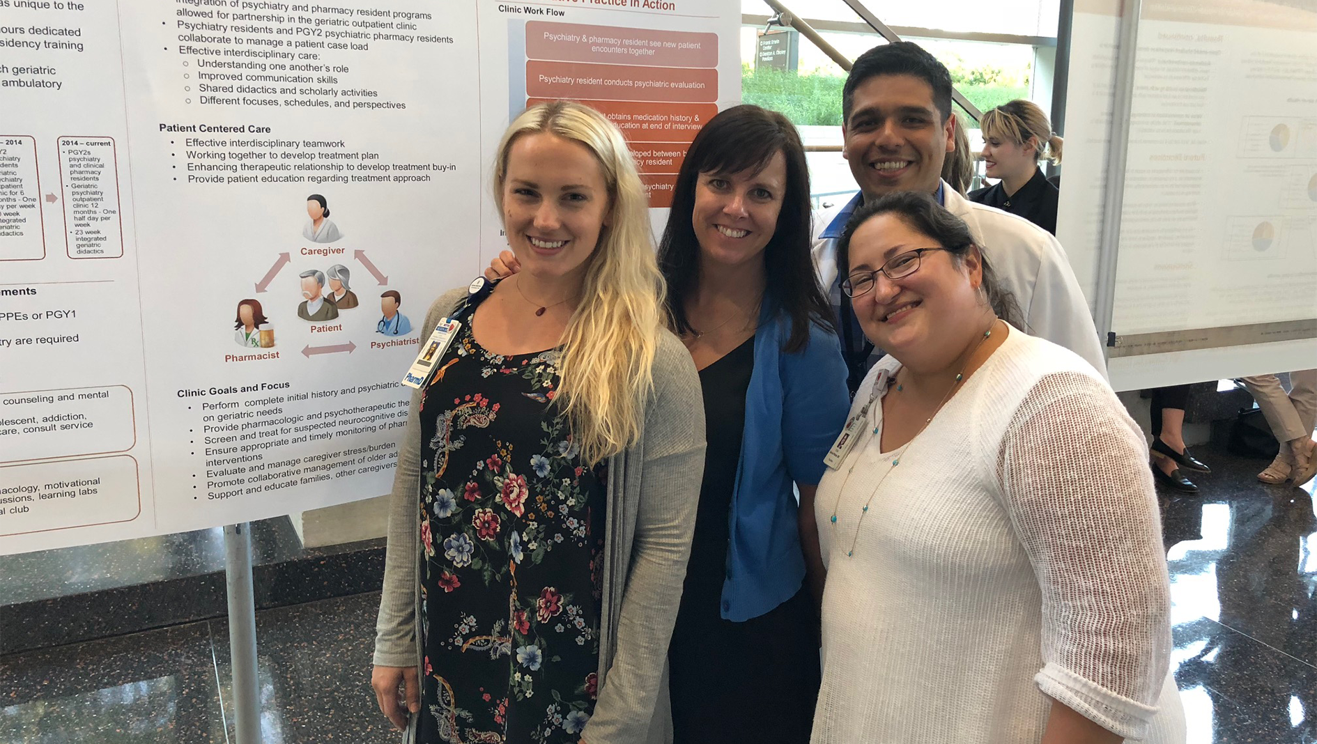 Members of the Geriatric Psychiatry Fellowship at Dell Medical School together in front of a presentation poster.