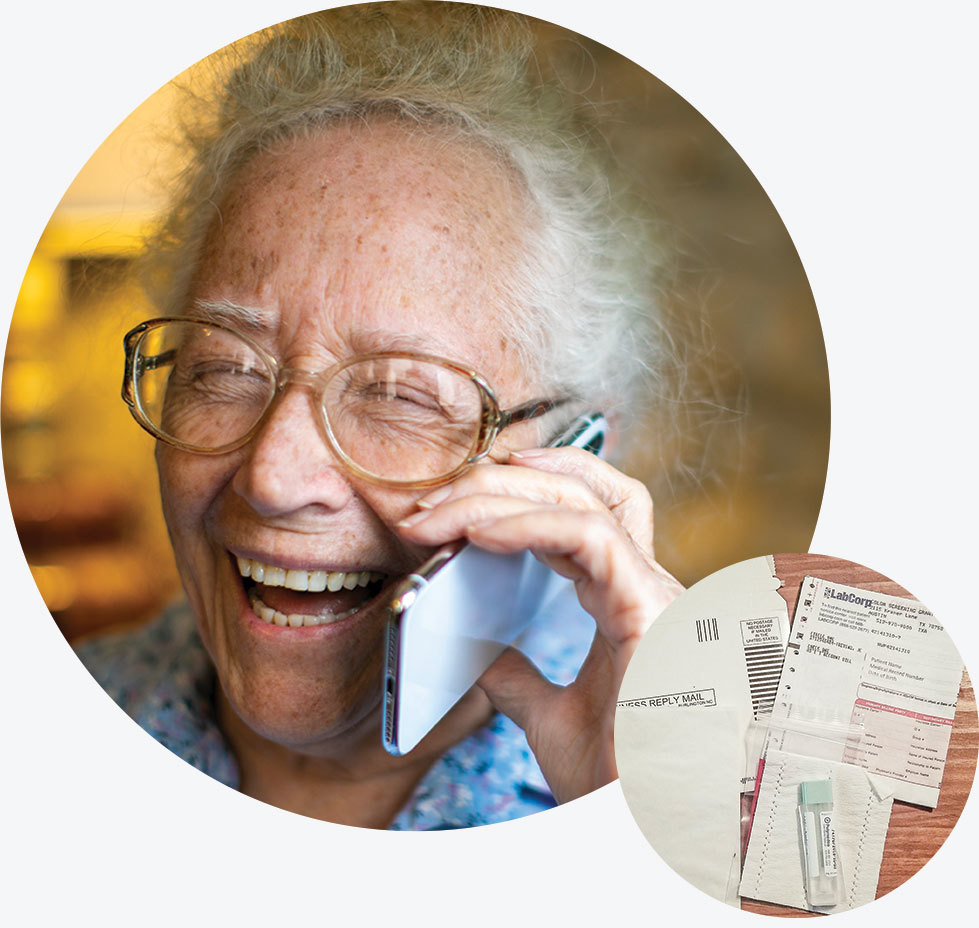 An older man talks on the phone next to a sample colorectal cancer screening kit.
