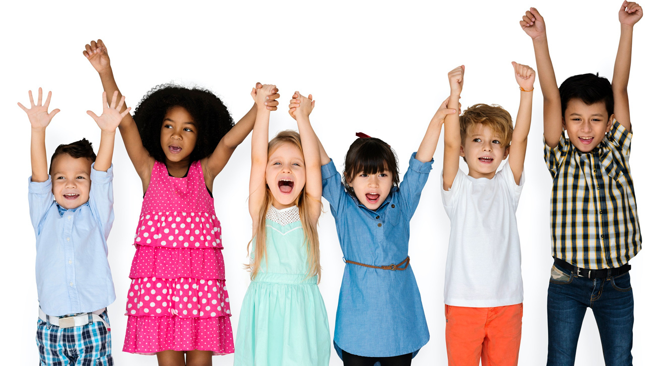 Stock image of six young children throwing their hands in the air in glee.