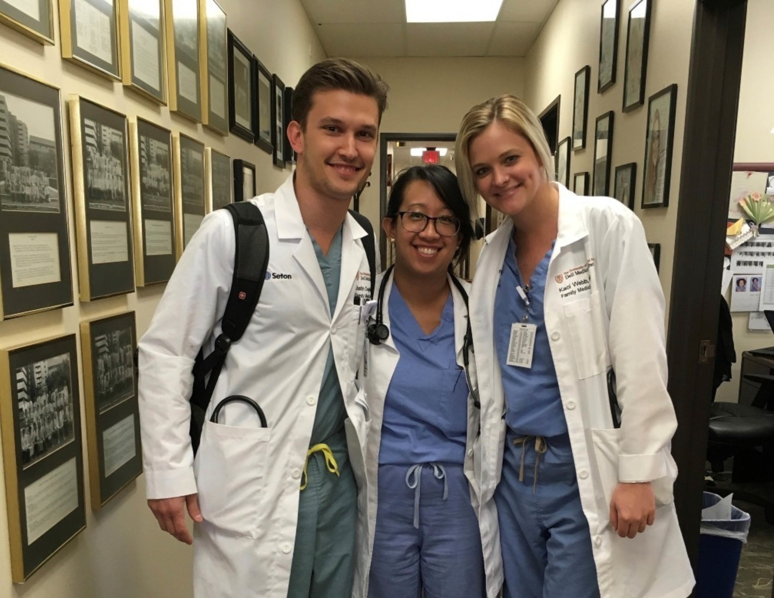 Three residents in scrubs.