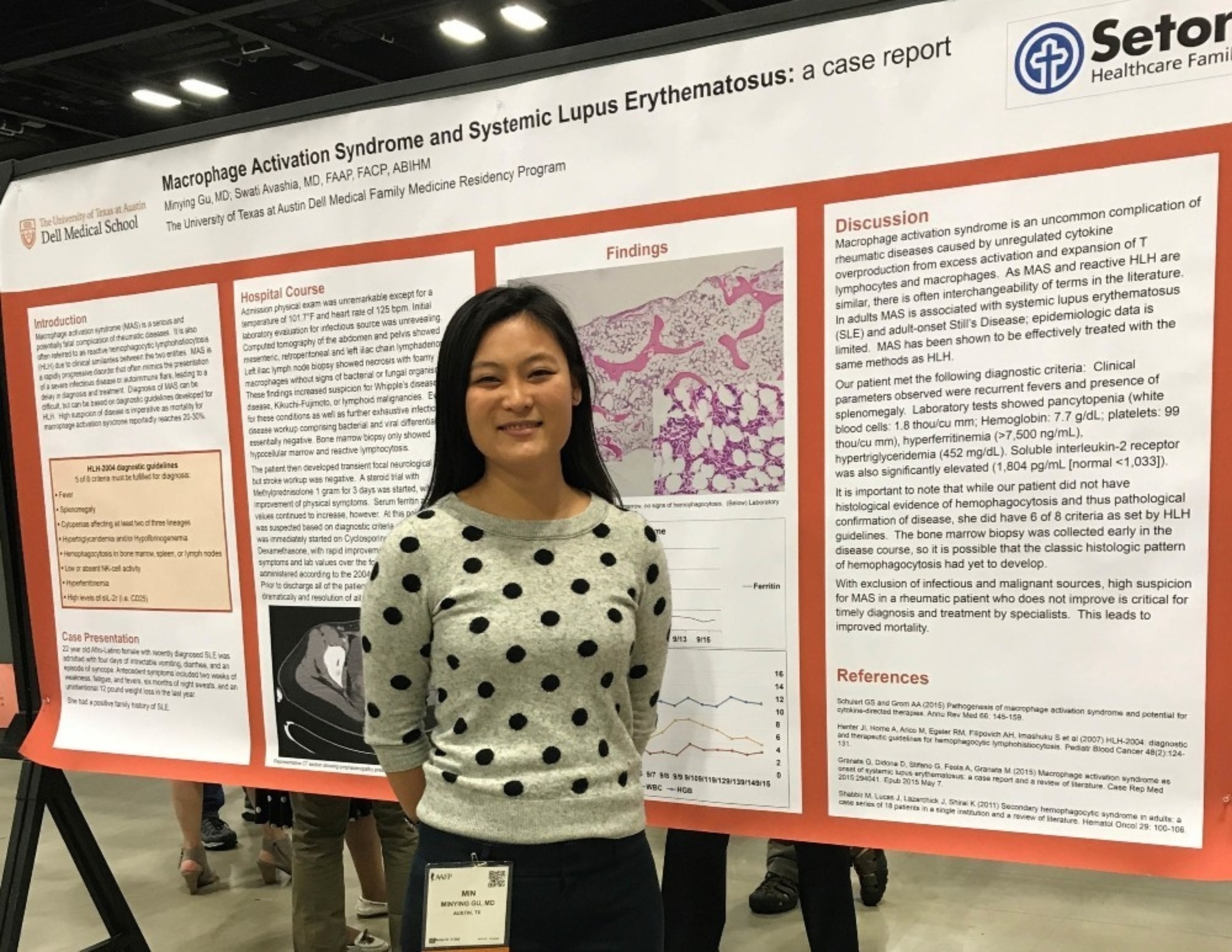 A female resident presenting a research poster.