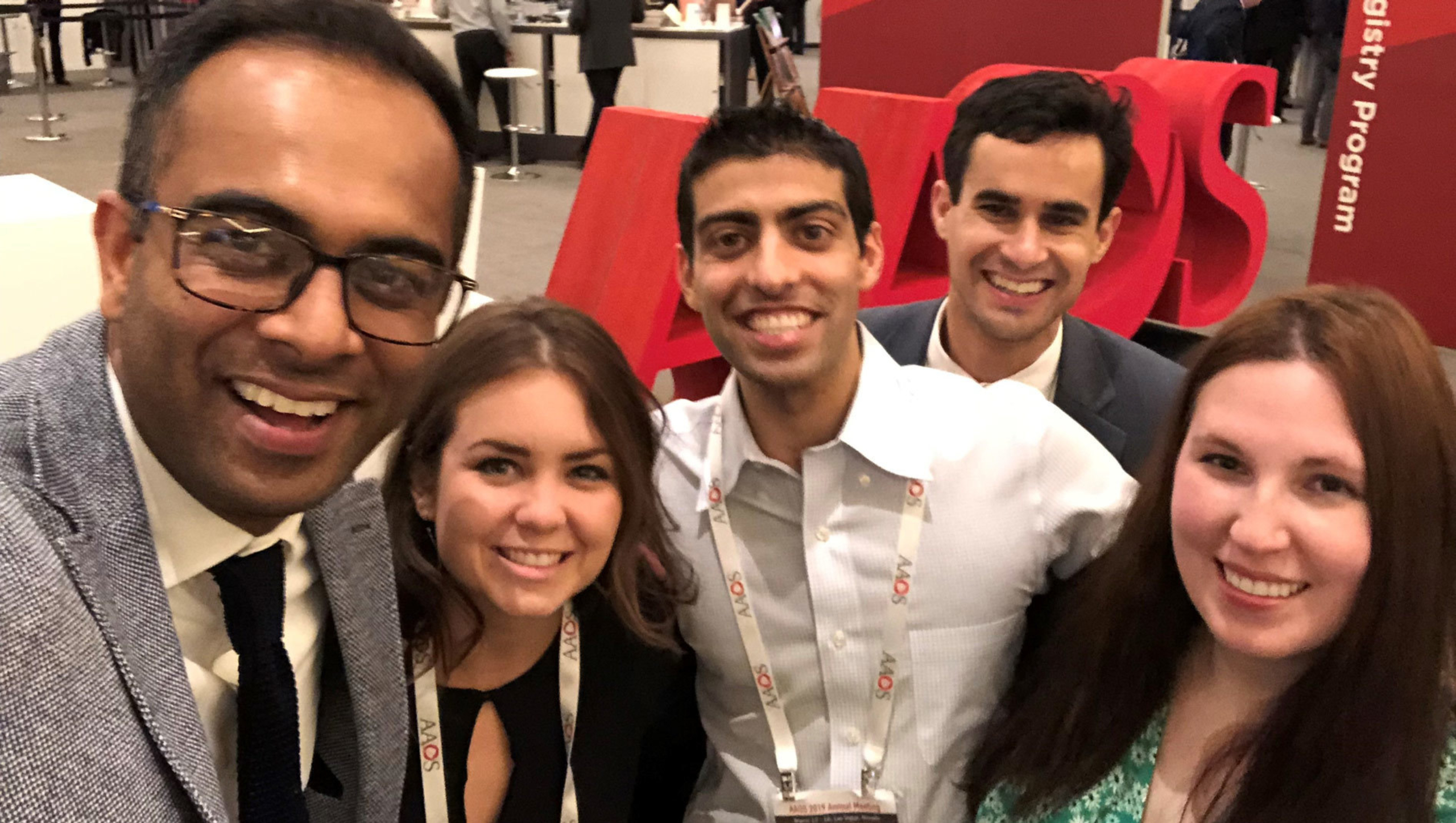 Value-Based Health Care fellows in a group at a conference.