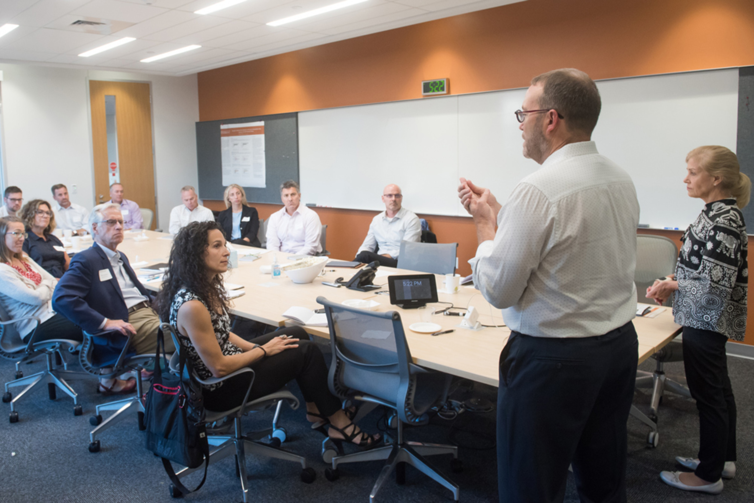 Elizabeth Teisberg and Scott Wallace present to a group during the Musculoskeletal Institute's Immersion Program in Value-Based Health Care.