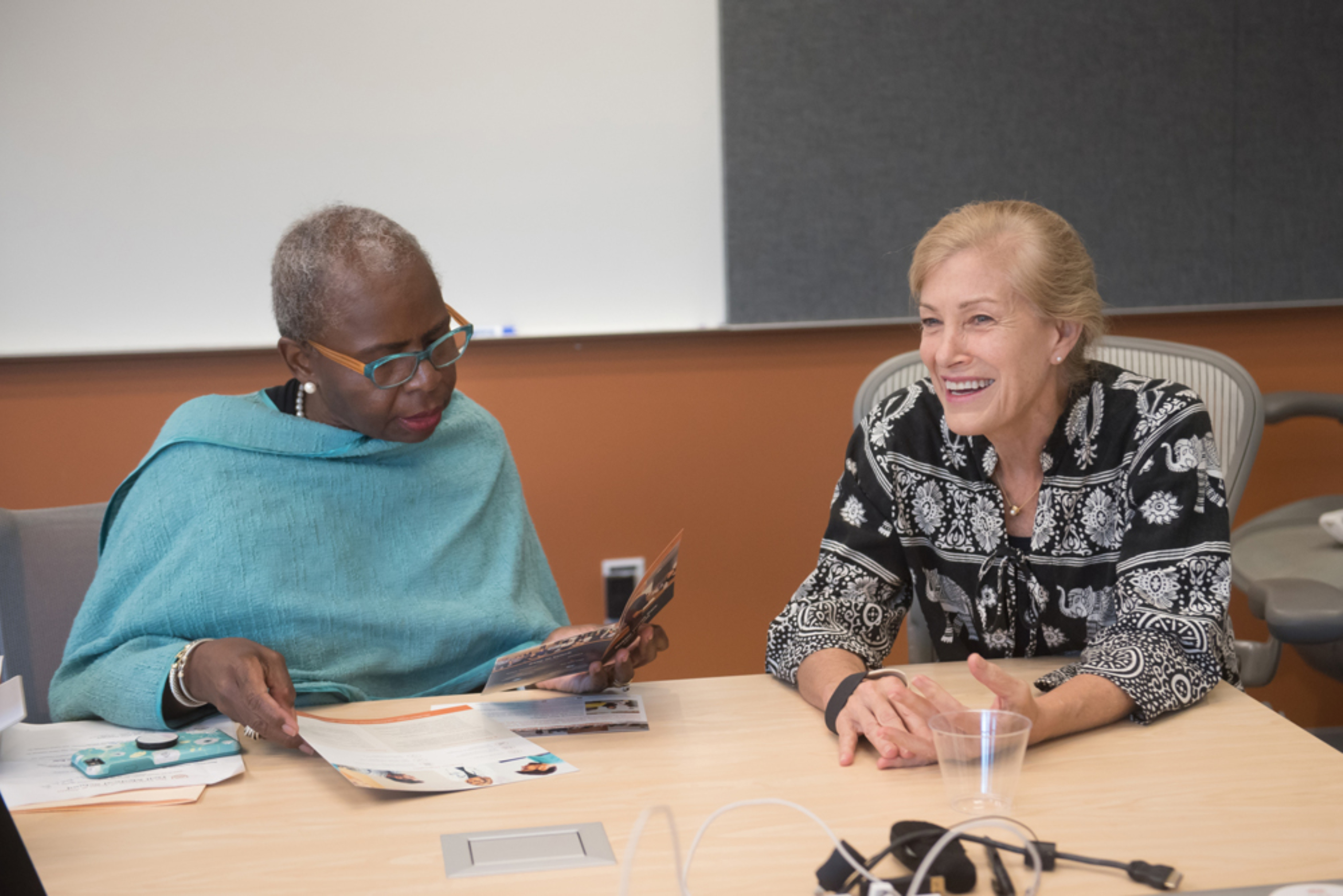 Elizabeth Teisberg reviews material with a participant during the Musculoskeletal Institute's Immersion Program in Value-Based Health Care.