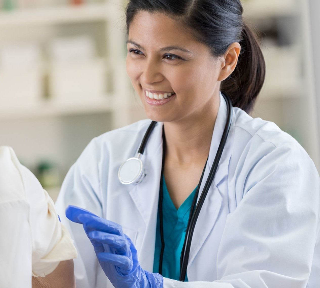 Doctor smiling while providing care
