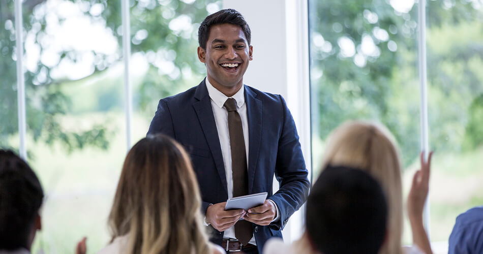 Smiling man giving presentation