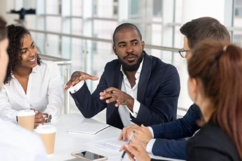 Organizational leader discusses plans for improving processes with coworkers.