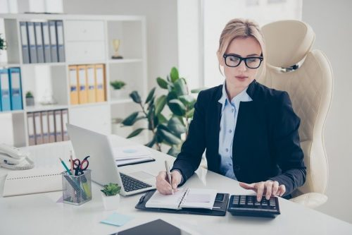 Budget analyst working at her desk