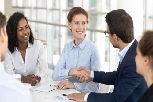 Ethical business communicators in a meeting