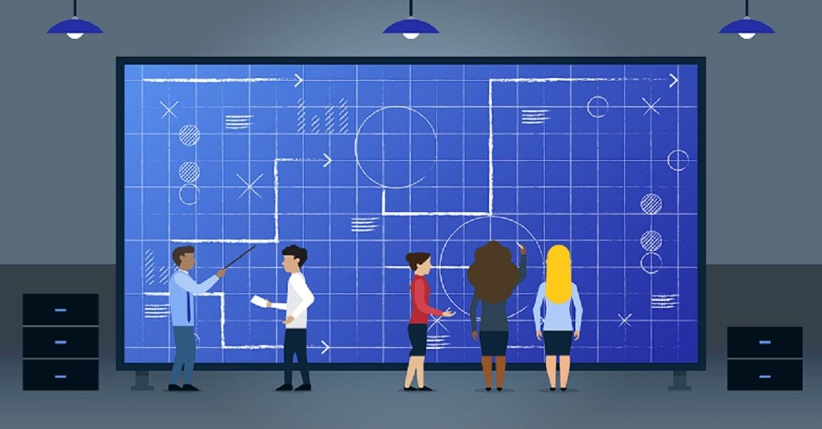 People review business strategy on large screen