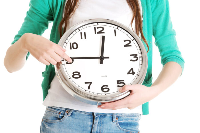 Student holding clock