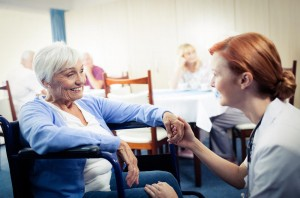 Nurse with elderly nursing home resident
